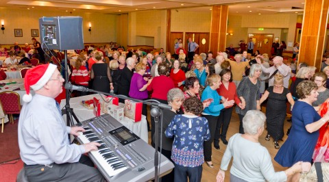 Danny Brown keeps the music going as all those at the Citywide Christmas Tea Dance take to the floor for some dancing. Photo: William Maher WMCM Photography.